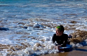 Mali enjoying boogie boarding in the Atlantic surf