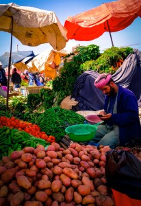 Local vendor checking his mobile phone