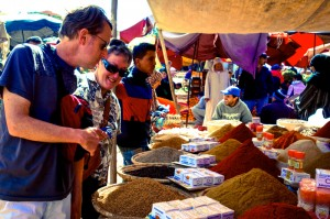 Aaron and Grammy Sue shopping for spices in the weekly Aourir market