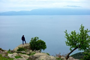 """Aaron the Explorer"" looks out at the island of Lesbos, Greece"