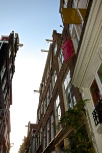 Narrow homes rely on top story pullies for large goods