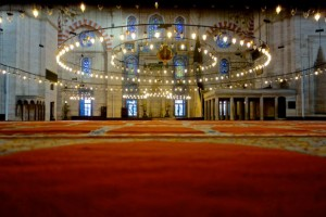 Expansive rugs and chandeliers of Suleyman Mosque