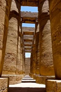 Dwarfed by Karnak Temple pylons