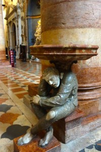 """Hunchback"" holding holy water at Sant' Anastasia"
