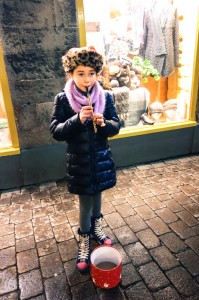 Young busker plyer her trade on a pipe