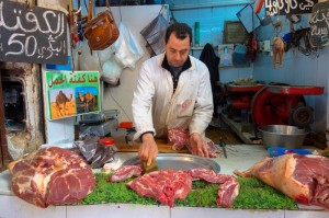 Butcher advertising fresh camel meat