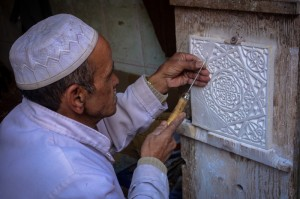 Traditional plaster carver in the souk