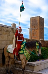 Guard with the 12th Century Hasan Tower