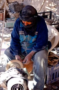 Local lapidary preparing fossils for sale