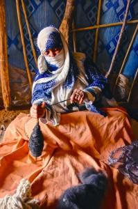 Berber grandma spinning camel wool