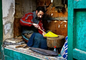 Babouch (shoe) cobbler at work in his souk in the UNESCO Heritage Site old medina